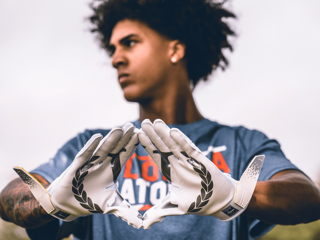 Have the perfect hand positioning to get better at catching football