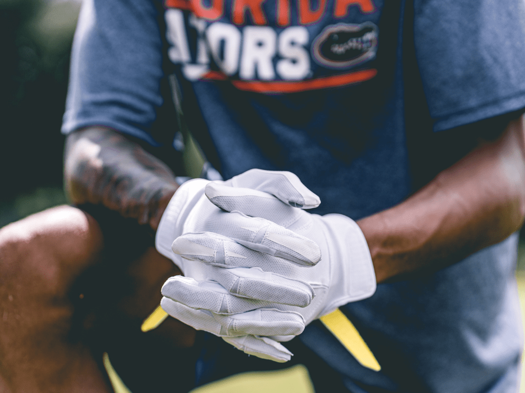 Catch the football with your hands to get better at catching football